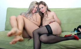 two-beautiful-young-lesbians-have-fun-with-a-strap-on-toy
