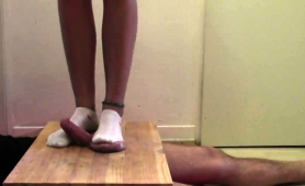 dominant-babe-with-sexy-legs-punishes-a-dick-with-her-feet