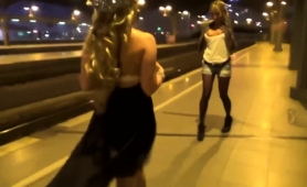 two-wild-babes-worship-a-cock-and-share-a-hot-load-in-public