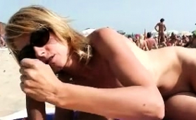 nudist-couple-engaging-in-sloppy-oral-sex-right-on-the-beach