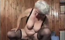 buxom-granny-in-stockings-has-a-young-stud-plowing-her-pussy