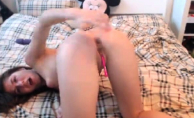 cute-brunette-camgirl-has-a-pink-toy-making-her-pussy-happy