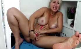 Big Breasted Blonde Cougar Feeds Her Desire For Masturbation