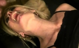 nasty-mature-blonde-welcomes-a-hot-load-of-cum-on-her-face