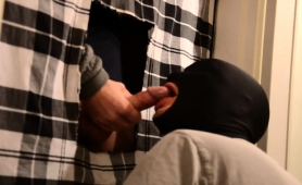 Masked stud kneels down and worships a glory hole cock